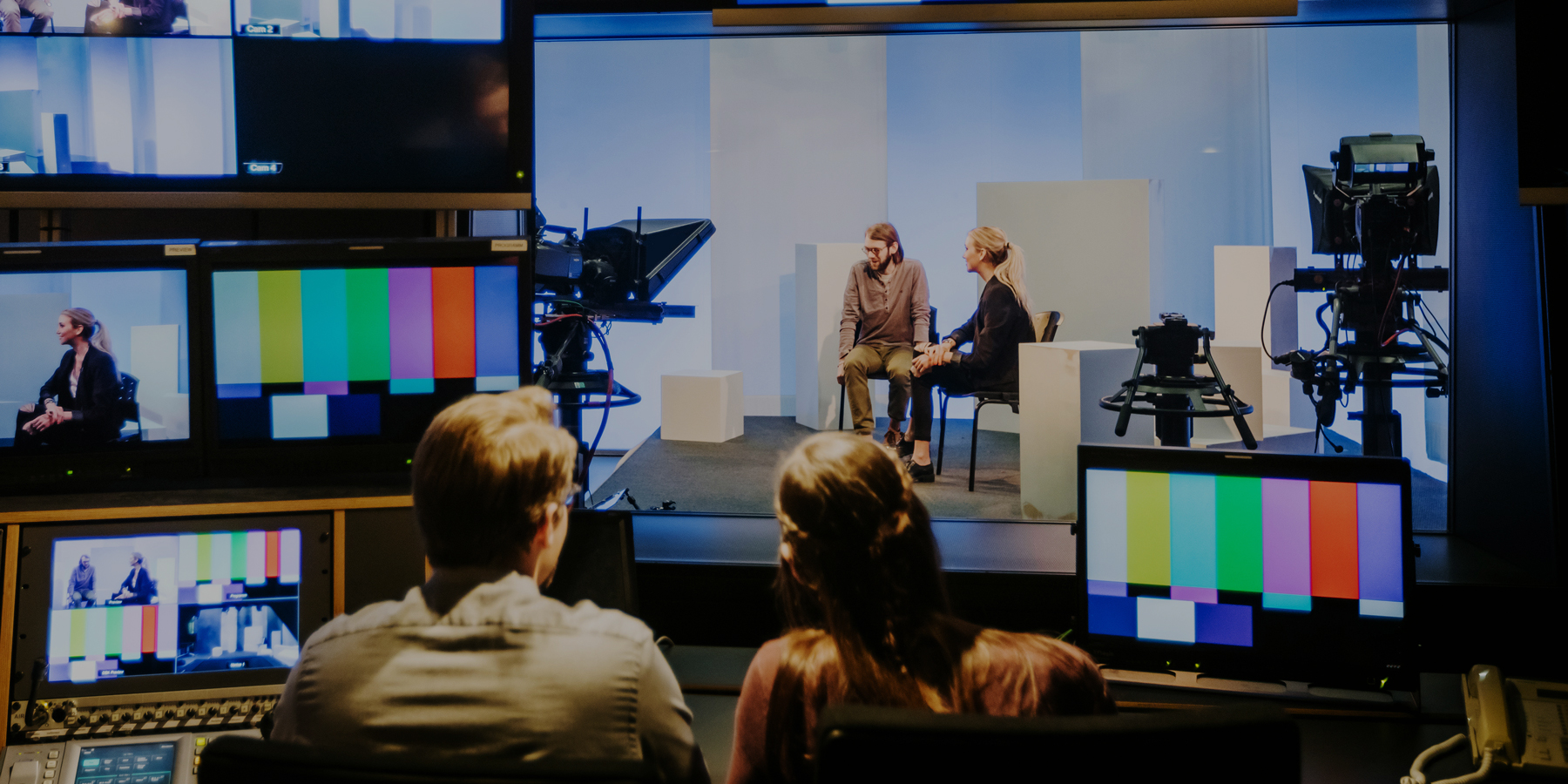 Students filming in a television studio
