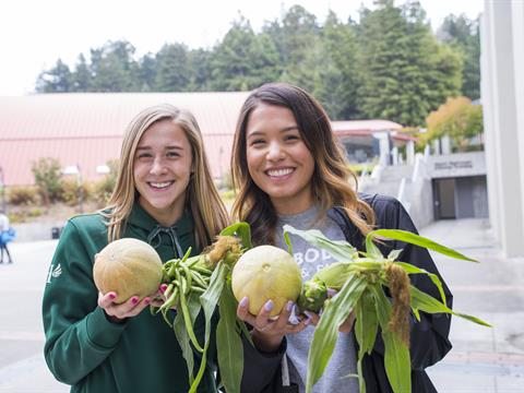 Students with fresh fruits and vegetables