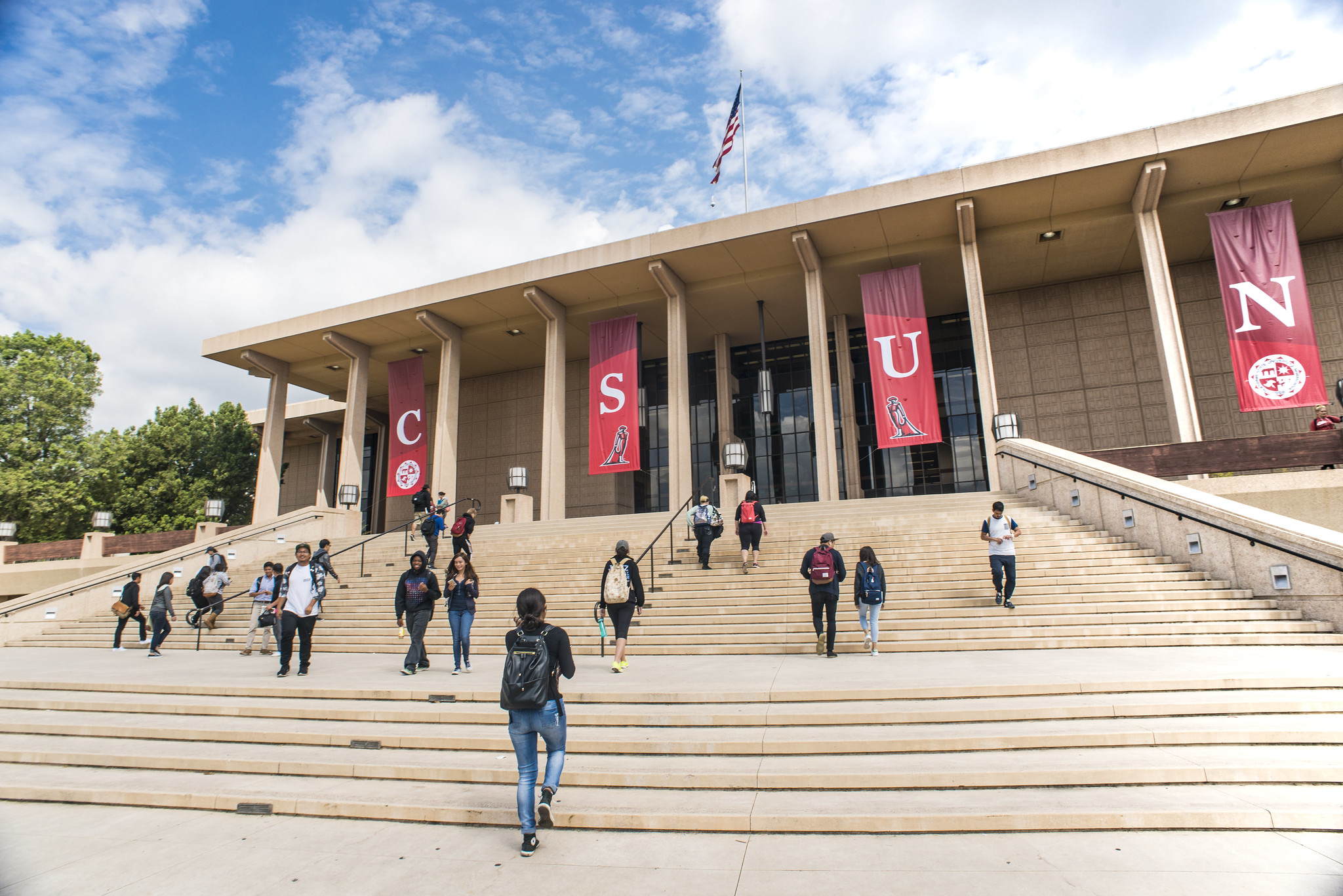 Students walk up the steps of the CSUN library.