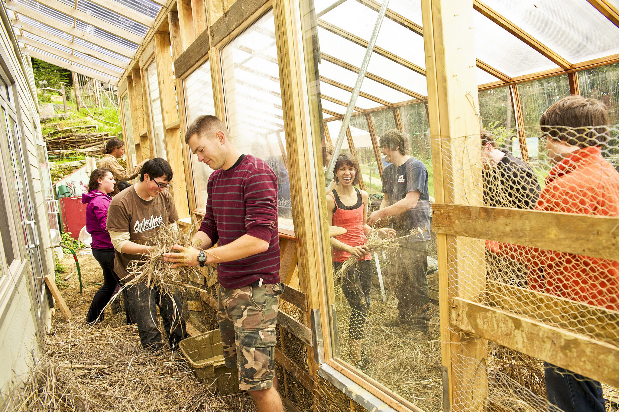 Humboldt State students in greenhouse.