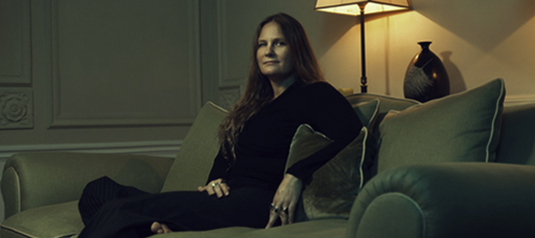 Lidia Yuknavitch sitting on a couch