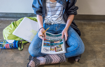 student looking at Humboldt State catalog