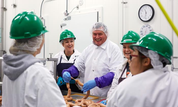 Chancellor White learns to make sausage at Cal Poly San Luis Obispo in 2015.