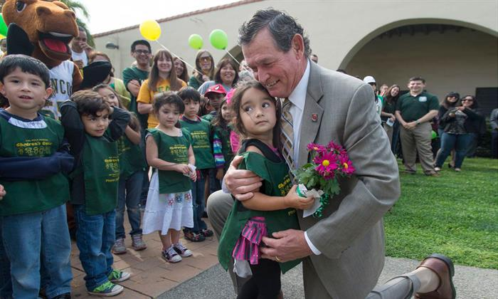 Chancellor White with kids at Cal Poly Pomona in 2013.