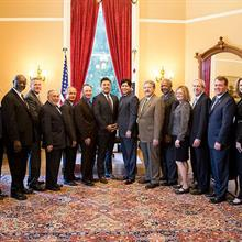 Senate President Pro Tempore Kevin de León, center, stands with CSU presidents and representatives during CSU Budget Advocacy Da