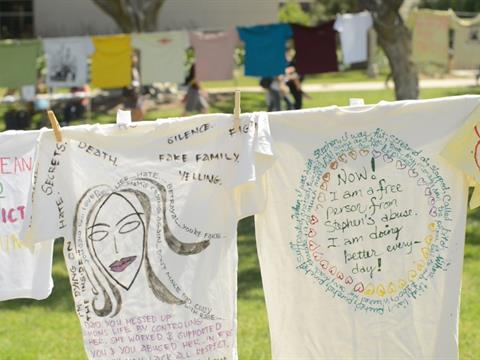 Shirts decorated by students for the Clothesline Project