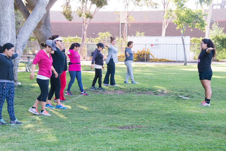Student leading workout session at the park