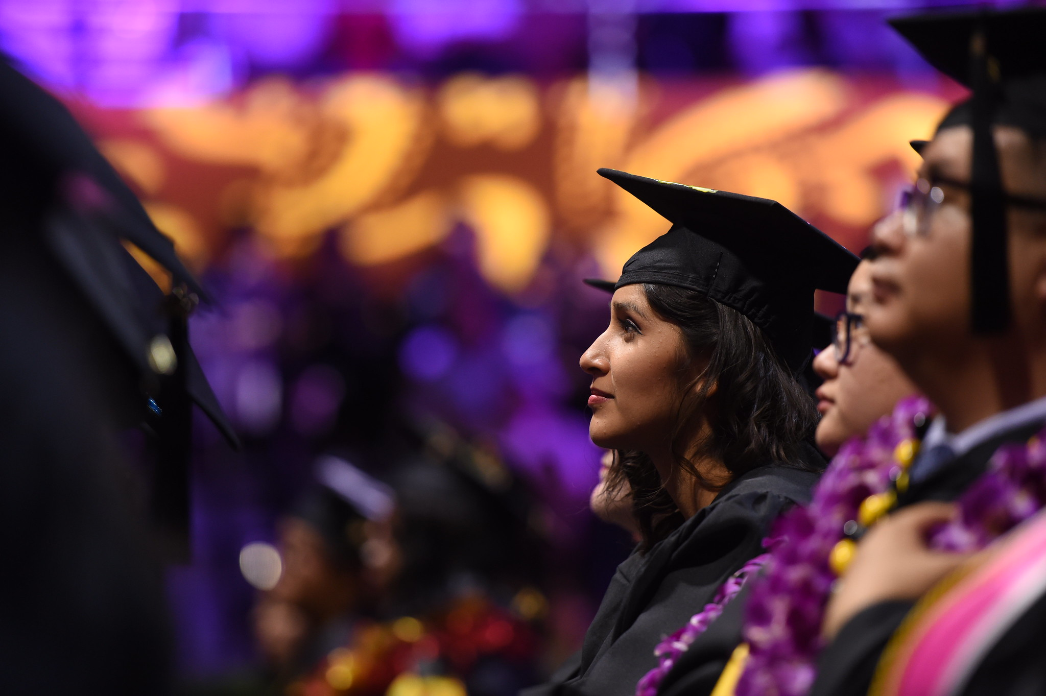 college graduate sitting during commencement ceremony