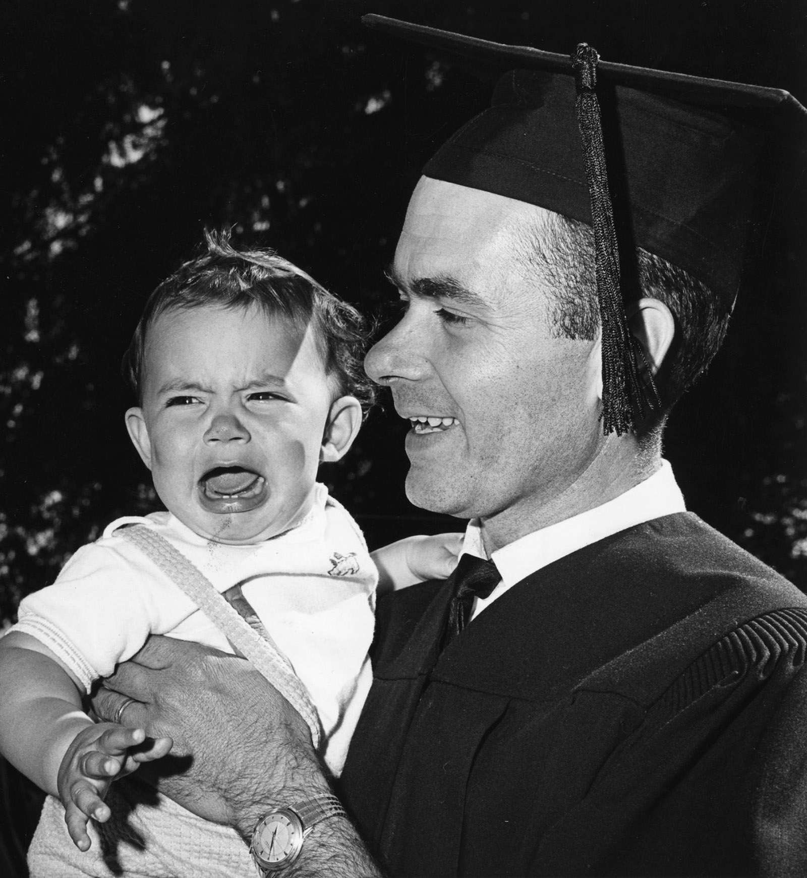 Kenneth Hinman holds his son Todd after his 1963 graduation, in which he received a bachelor's of arts in teaching.