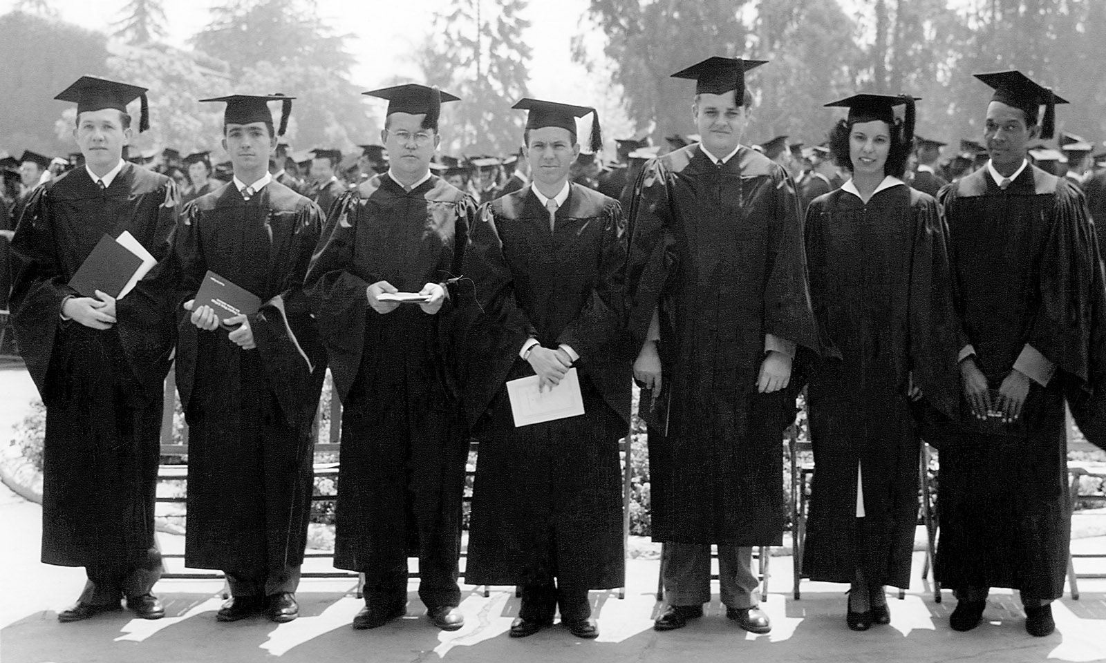 Some of the first graduates of Los Angeles State College in 1948 pose for a photo. This was officially the first Commencement, h
