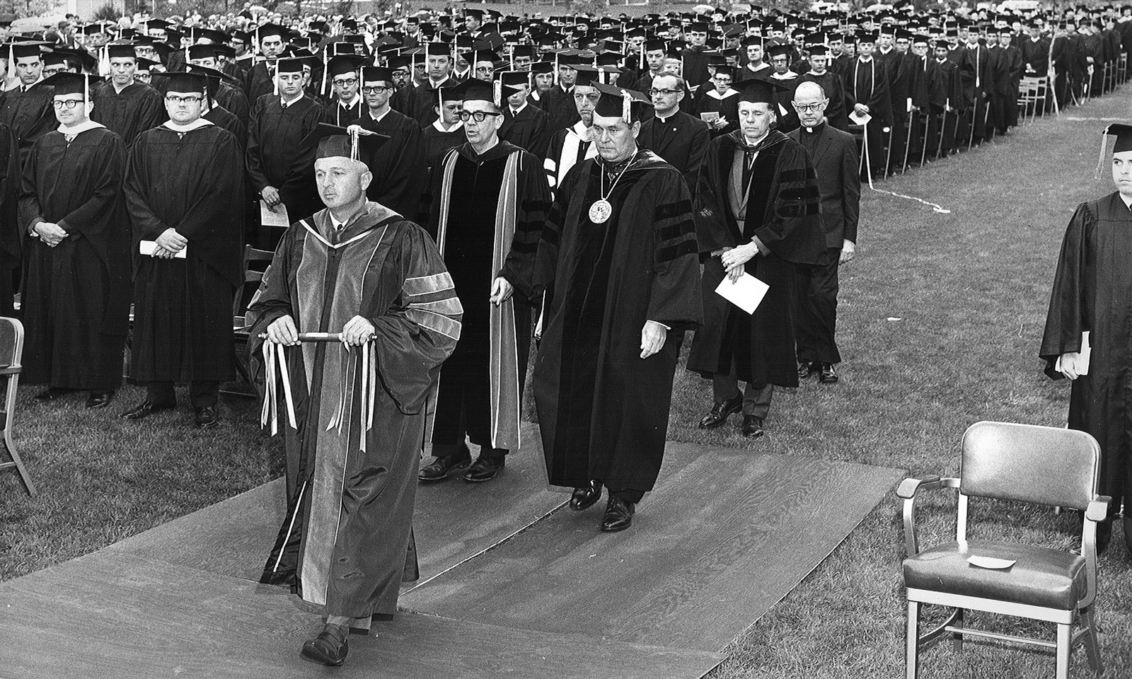 Former CPP President Robert Kramer walks to the stage during a Commencement ceremony in the late '60s or early '70s.