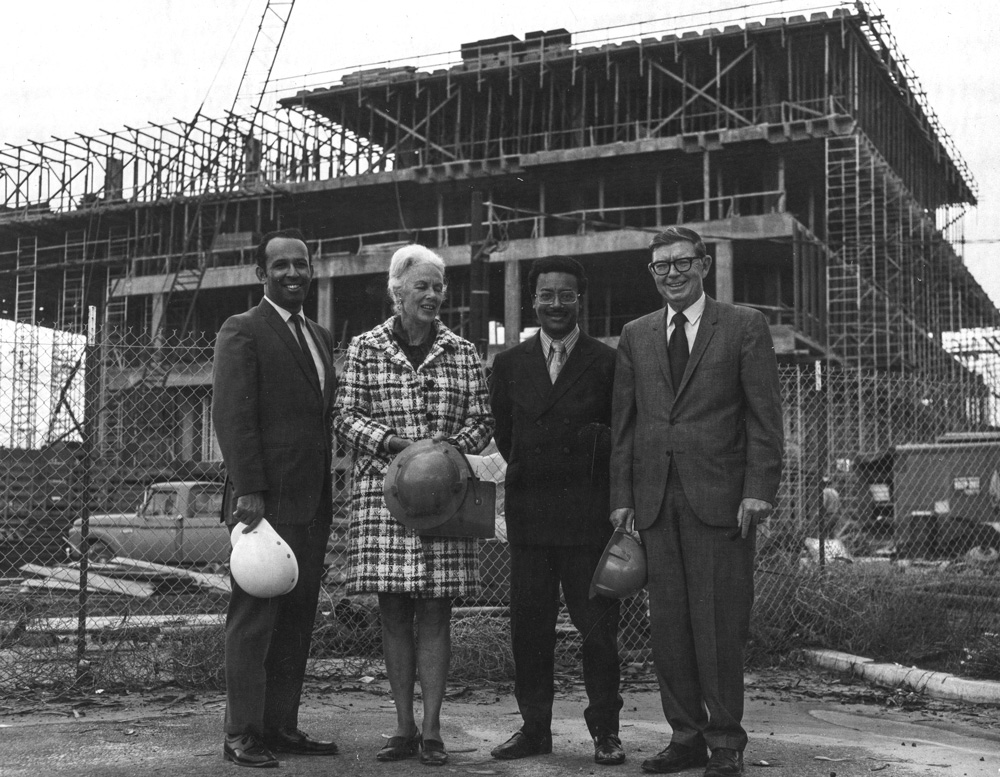 DOM​INGUEZ HILLS   1971Former president of CSU Dominguez Hills Leo Cain stands with administrators and campus visitors in front of the new library's framework.                  Left to right: Gilbert Smith, Polly Watts, Assemblyman Leon Ralph, President Cain.