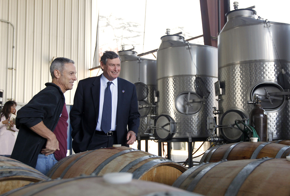 2013 Chancellor Timothy P. White and former campus winemaker/alumnus John Giannini (left) at Fresno State Winery. Fresno State became the first university in the U.S. fully licensed to produce, sell and bottle wine in 1997.