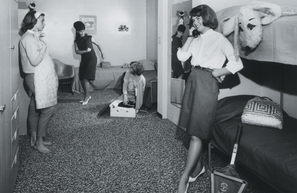1950s   Students pose to show what dorm life was expected to be like.