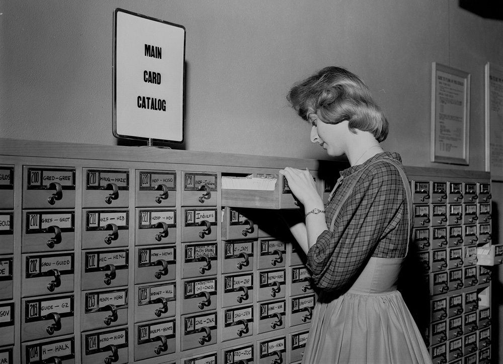Long Beach   1962A student ​searches the library's card catalog.