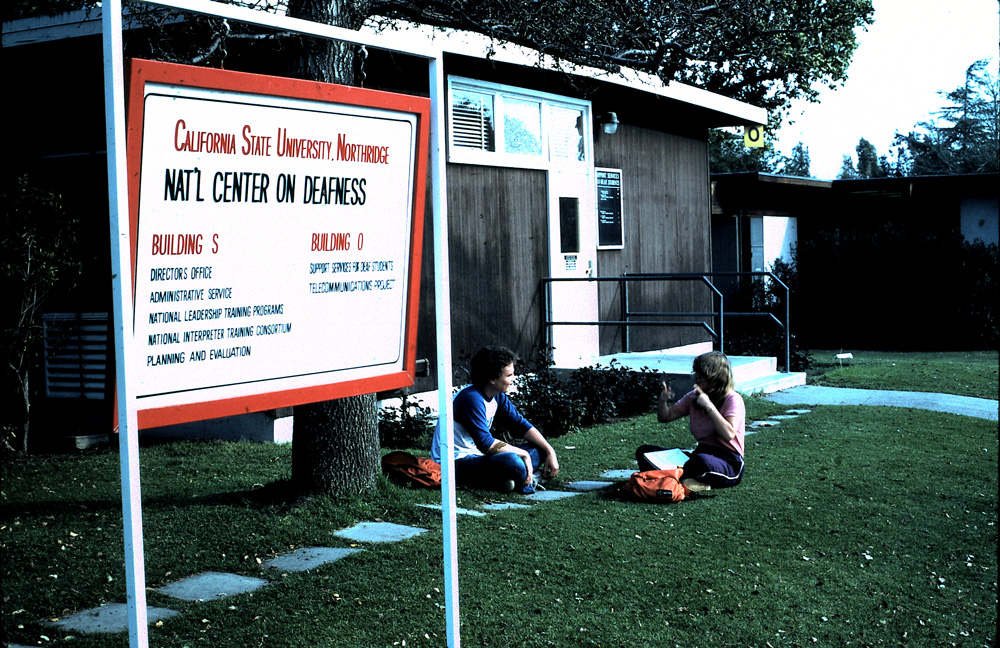NORTHRIDGE   1970s     Students take a respite on the lawn of CSUN's National Center on Deafness.
