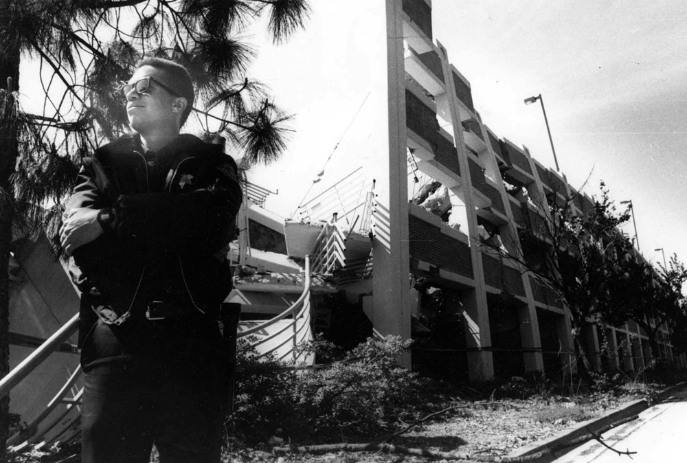 1994A police officer stands in front of parking structure C (now East Field and SRC Field), which sustained extensive damage in the 1994 Northridge earthquake.