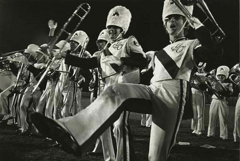 "1977     Members of Cal Poly's Mustang Band perform a distinctive tradition known as ""Georging,"" wild, spontaneous-looking dancing that is a carefully choreographed part of the show."