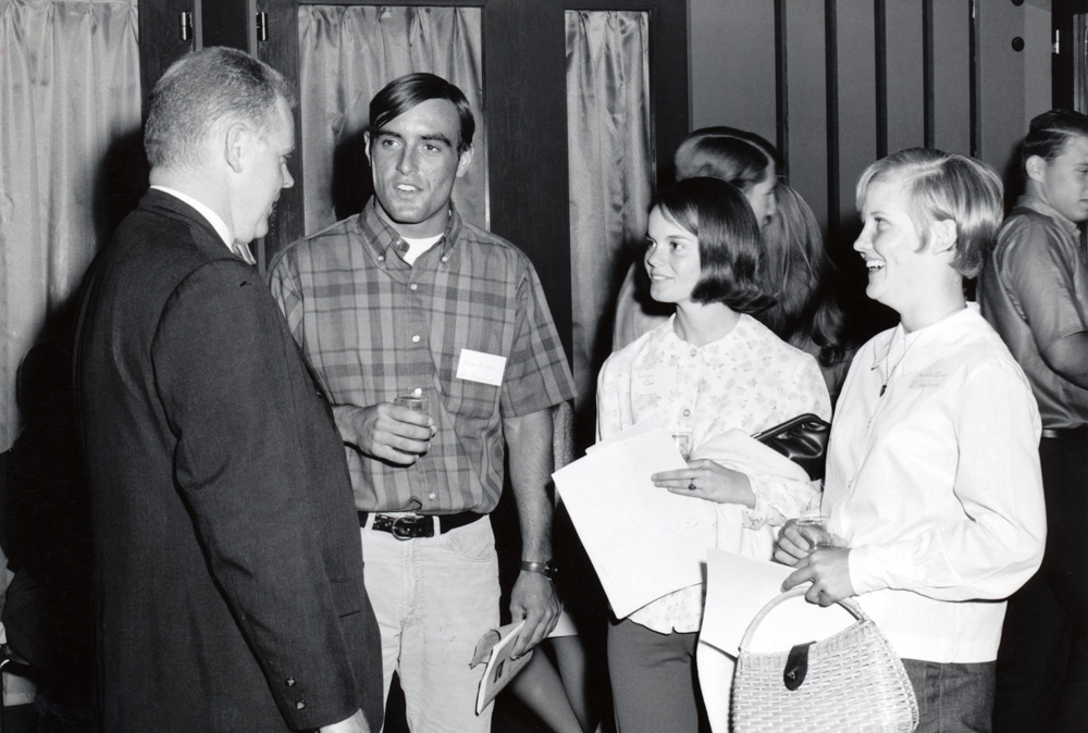 SAN BERNARDINO   September 1965                   John M. Pfau, founding president of CSUSB, welcomes students to the first day of classes.
