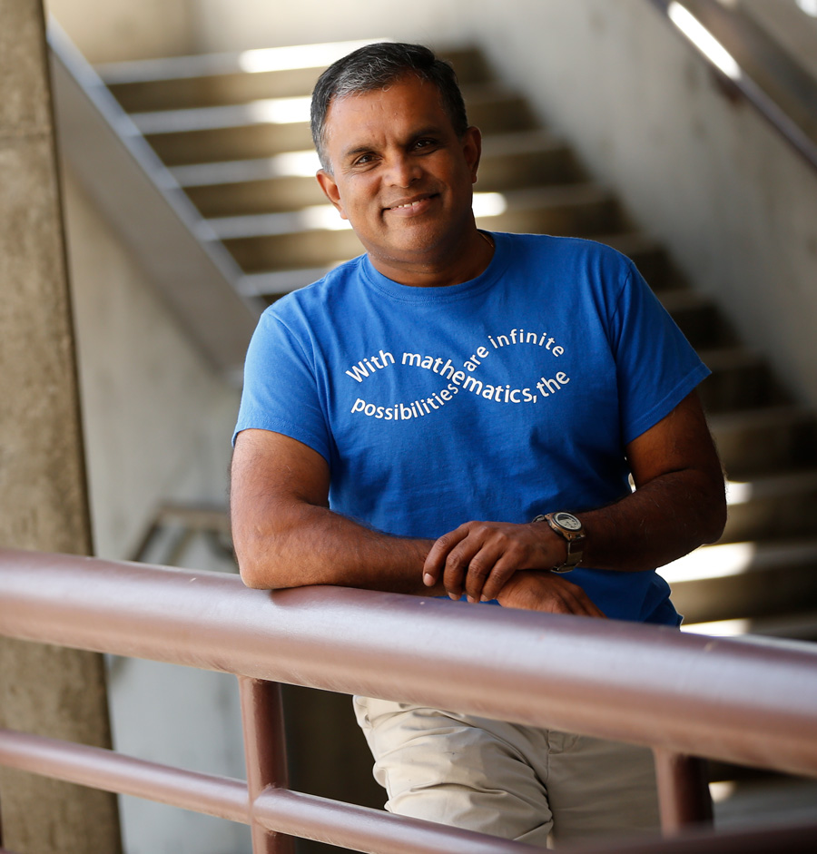 Dr. Rajee Amarasinghe poses in a stairway.