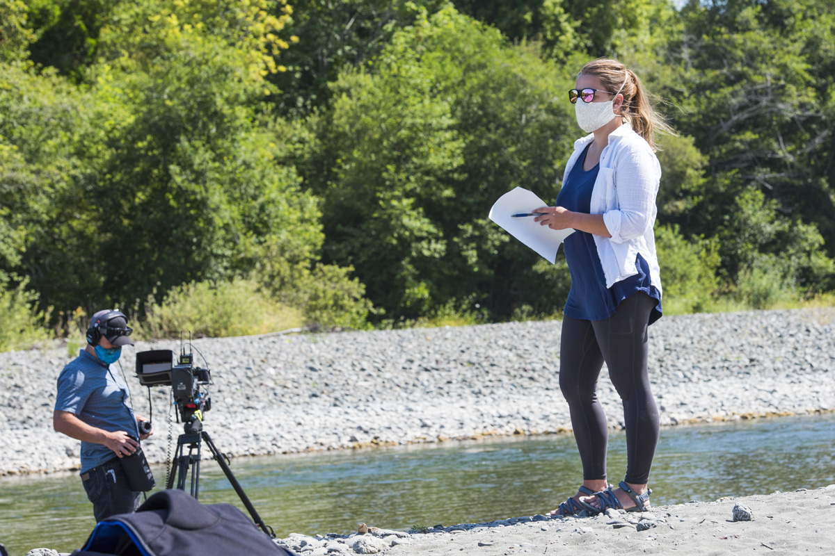 Humboldt State lecturer Amanda Admire wears a mask during the COVID-19 pandemic while filming river geomorphology .
