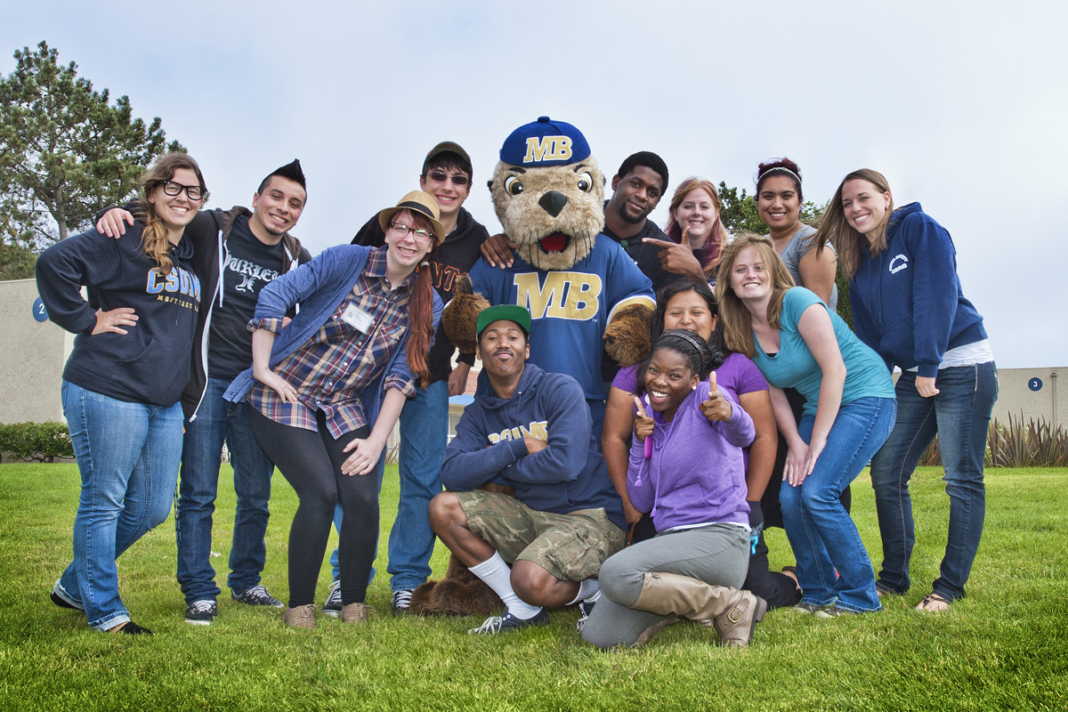 Students pose for a picture with Monte Rey on the first day of classes, Aug. 13, 2012. ​​