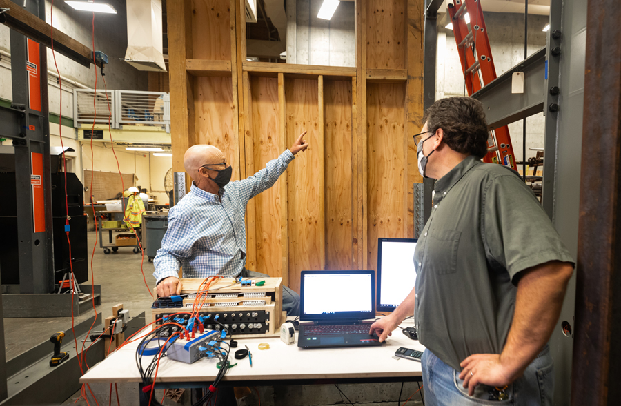 Professors John Lawson and Michael Deigert compare the computer results with actual conditions from a full-scale test on plywood walls, conducted by the students in their Fall 2020 ARCE 451 Wood/Masonry Design lab classes.