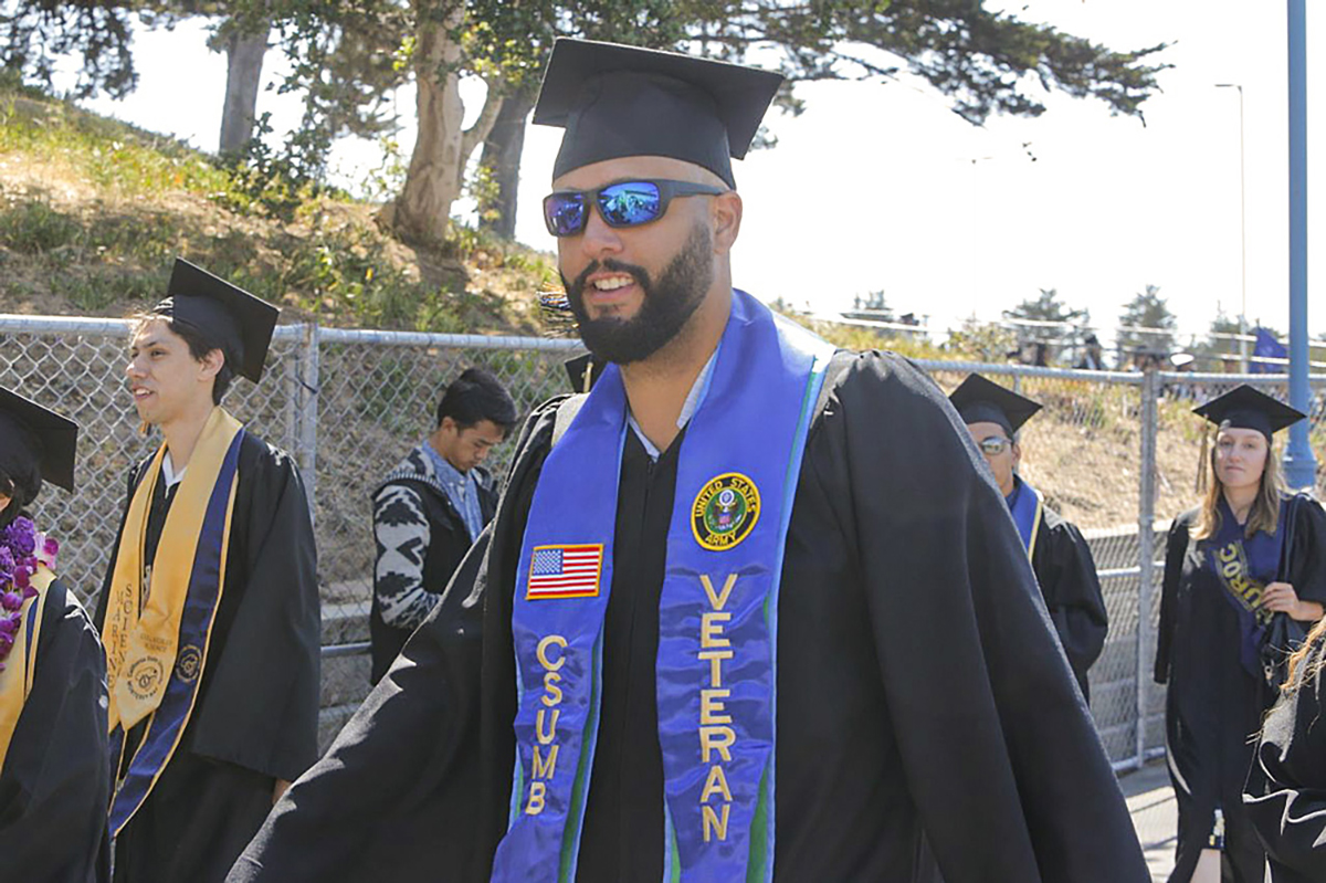 United States Army veteran Clifford Andrews flashes a smile during CSU Monterey Bay's commencement.
