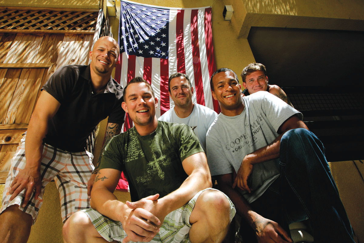 SDSU veterans pose with the United States flag on July 1, 2010.
