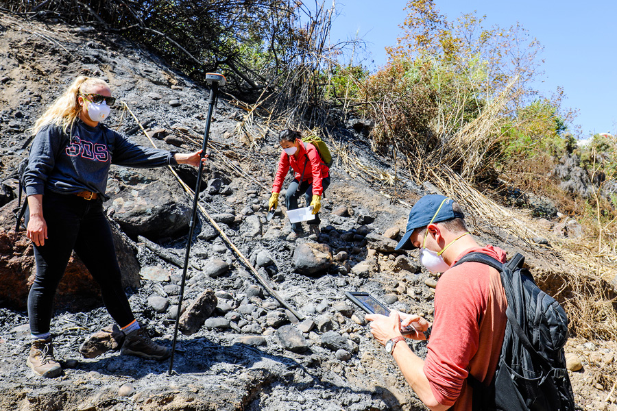 Engineering professor Alicia Kinoshita, Ph.D., and San Diego State students collect environmental samples to assess wildfire damage.