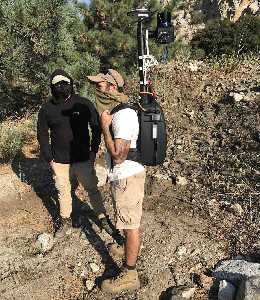 CSUSB Master of Science students, Seth Clemen Saludez (left) and Andrew Suarez (right), performing a scan with mobile backpack LIDAR technology at Mill Creek Fault in Mill Creek, San Bernardino Mountains.