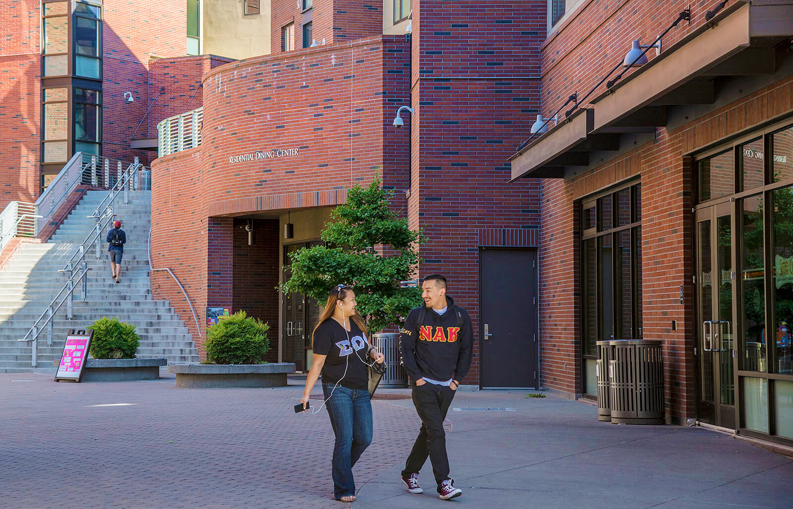 Students walking in front of campus building.
