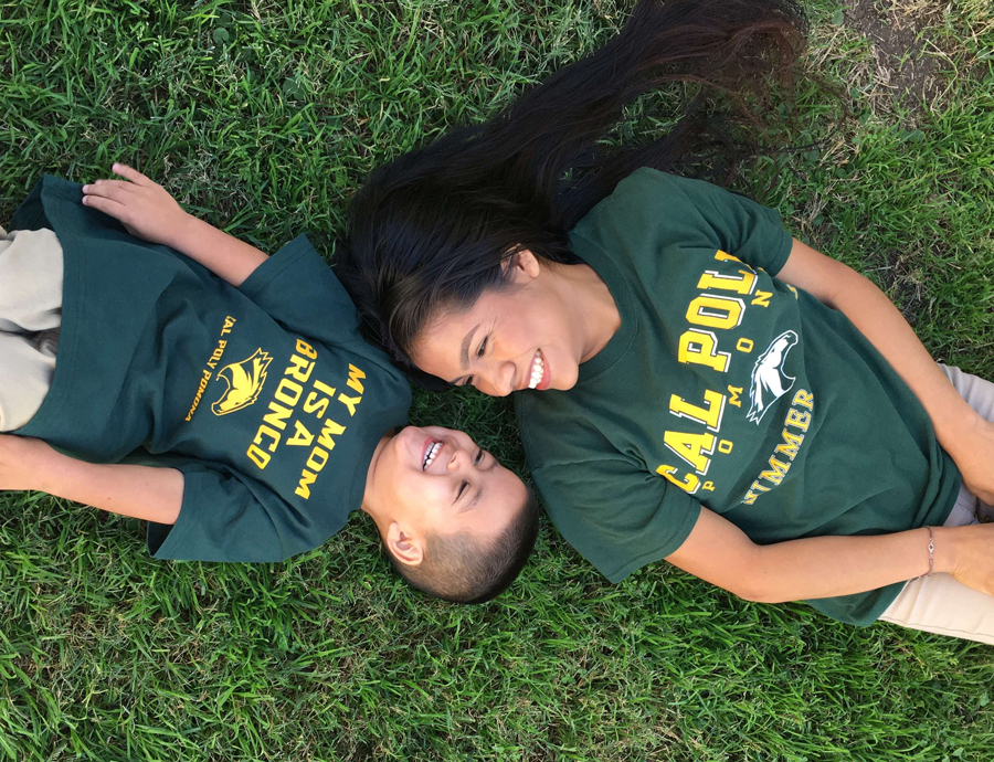 Yuliana Rosas and her son lying in the grass.