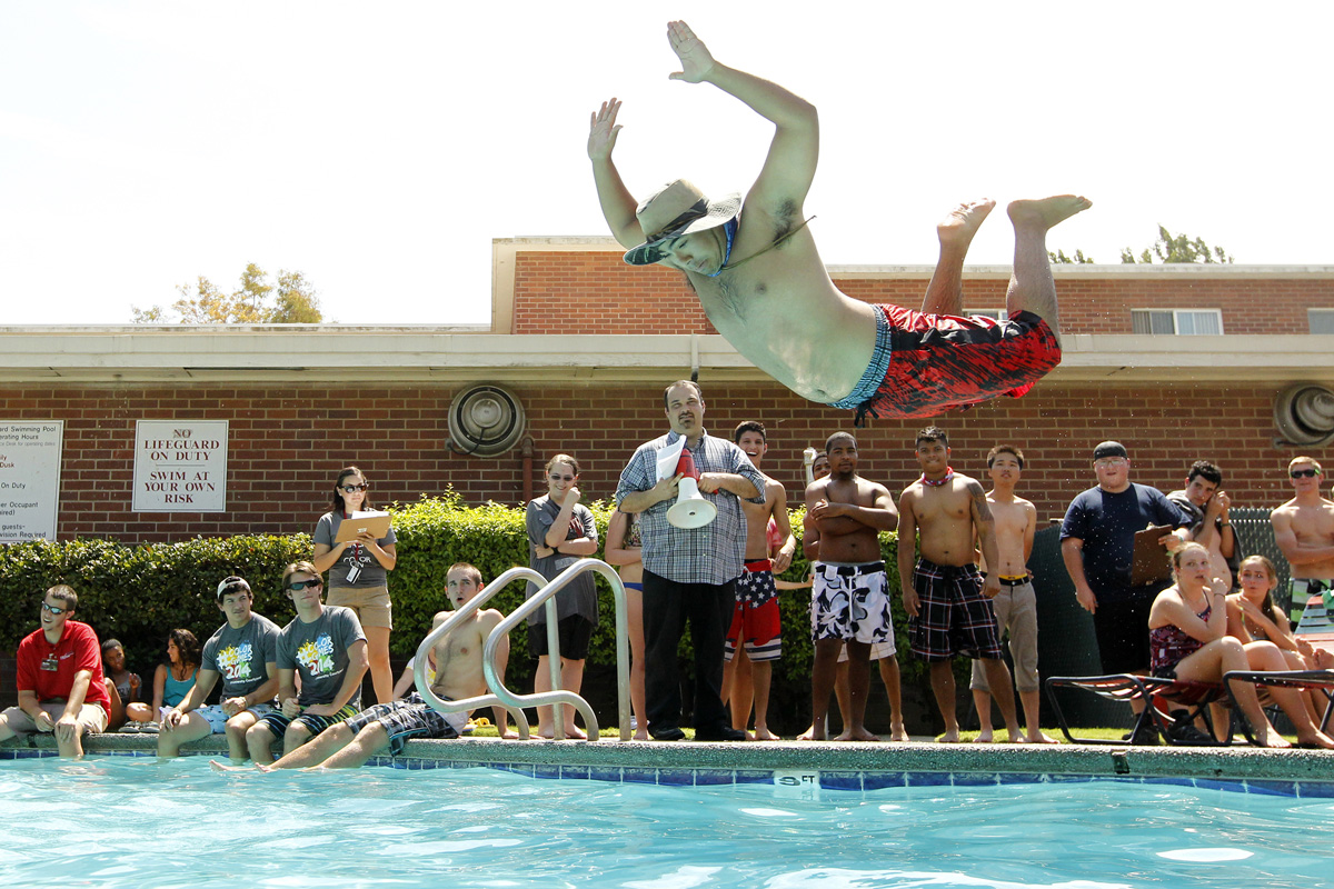 Manny Luna jumps into the residence hall pool during a Water Olympics competition