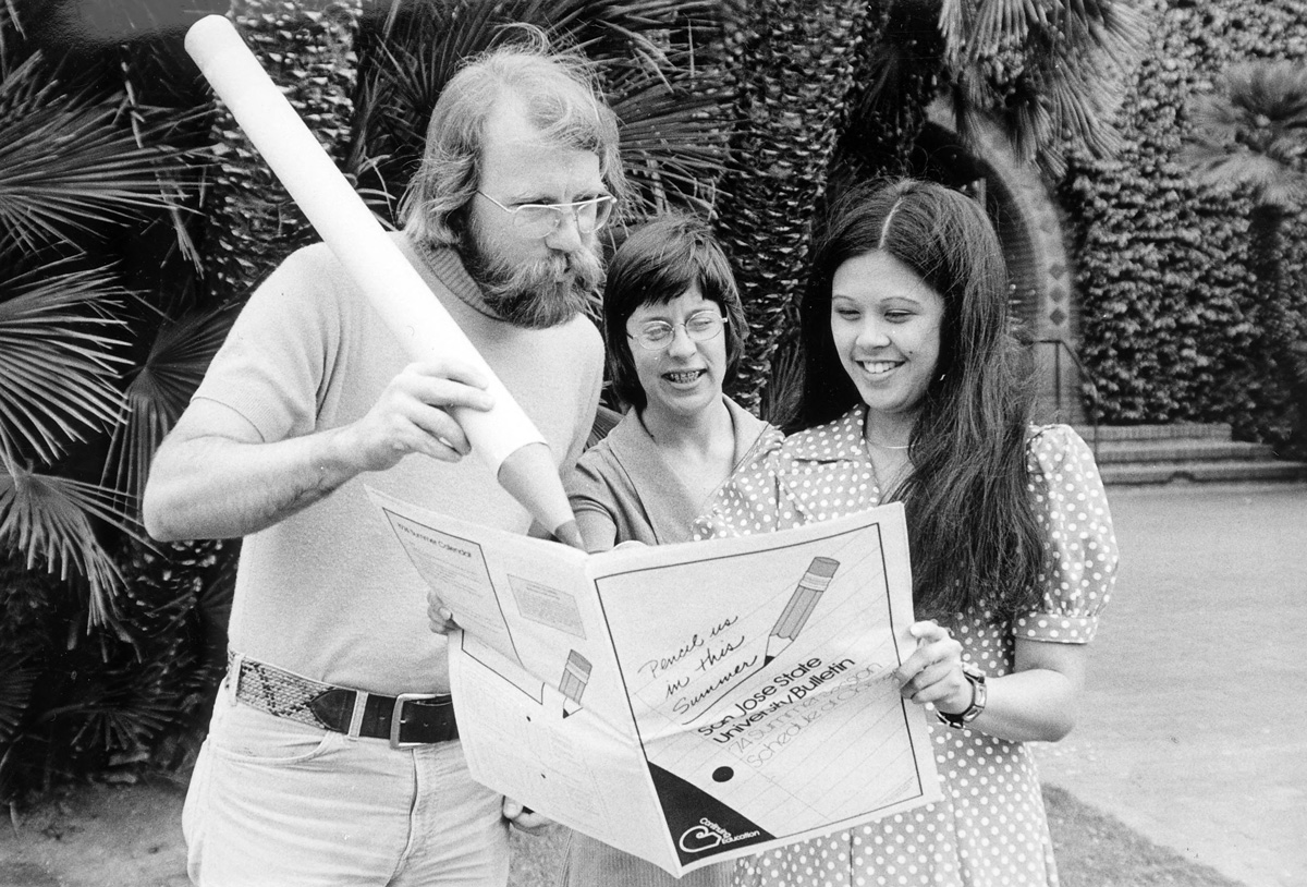 Members of the San José State campus community show off a 1974 summer bulletin.