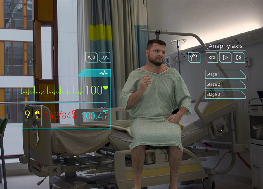 Holographic image of a patient actor sitting on a hospital bed.
