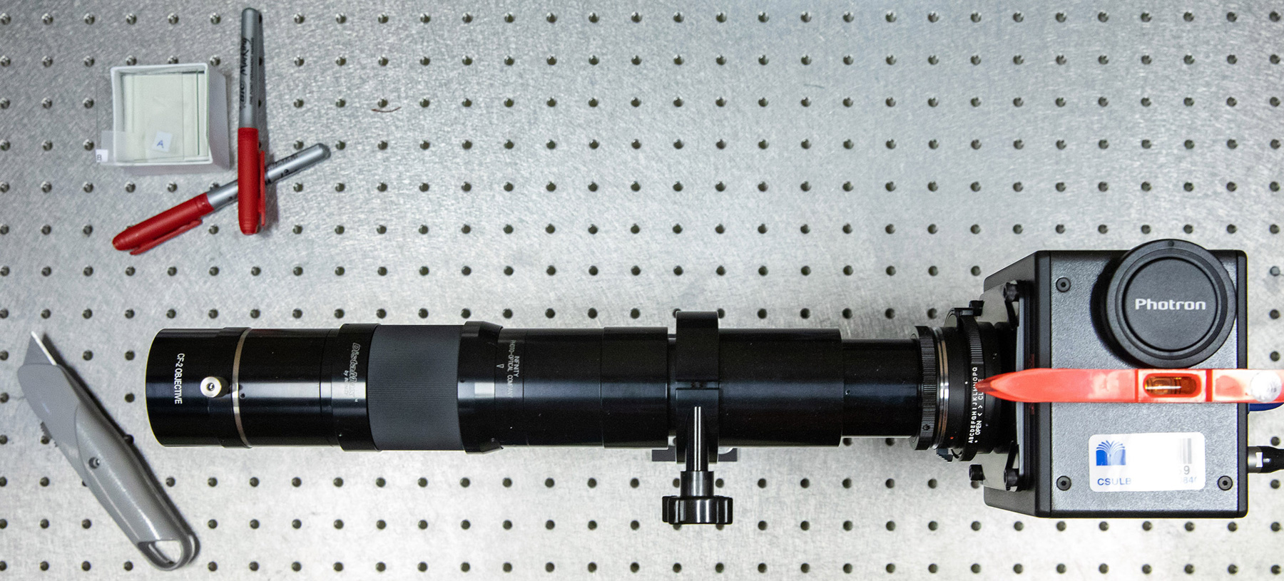 A camera with a long-distance microscope lens used to capture high-speed, high-resolution video for data analysis.