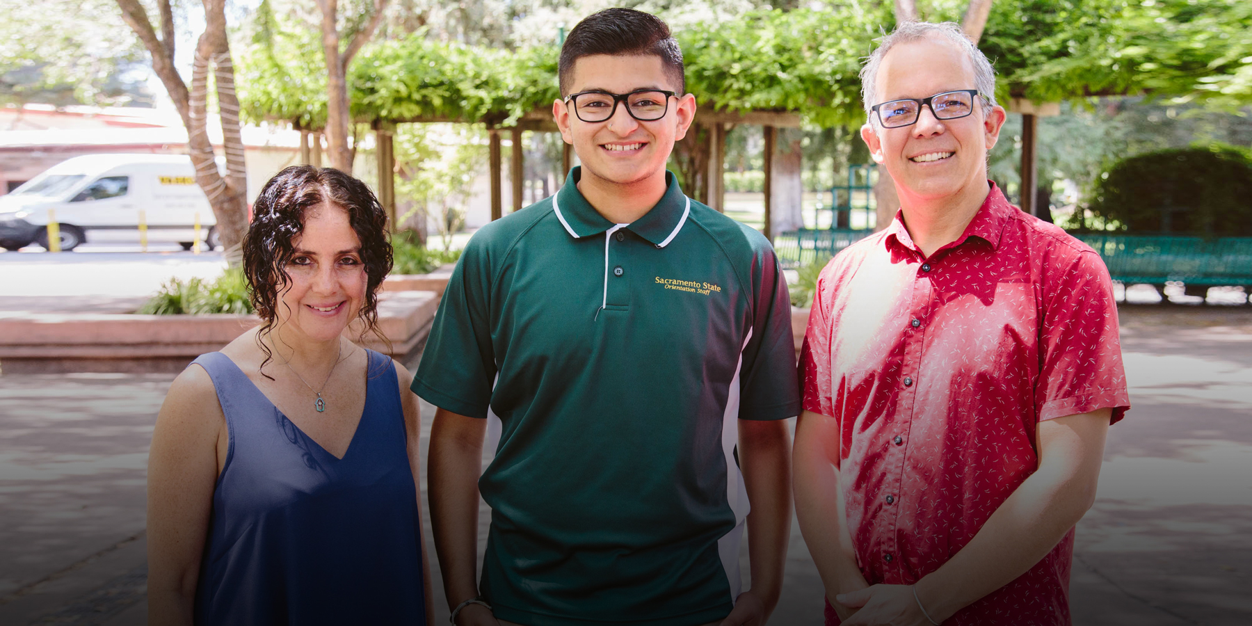 Ignacio stands with his professors Karen Levy and Michael Crain.