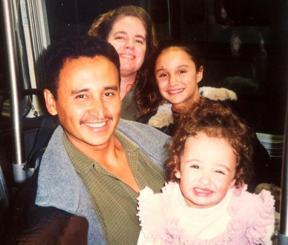 A younger Maria poses with her father, mother and sister.