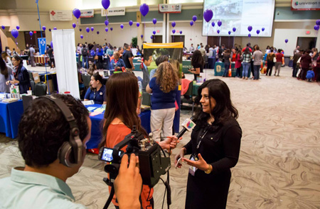 Univision Reporter interviewing a woman durring an Feria de Educacion event at Sacramento State