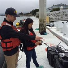 Interns Ben Potter (Cal Maritime) and Alice Dornblaser (Cal Poly SLO) pilot an ROV in Humboldt Bay, 2016