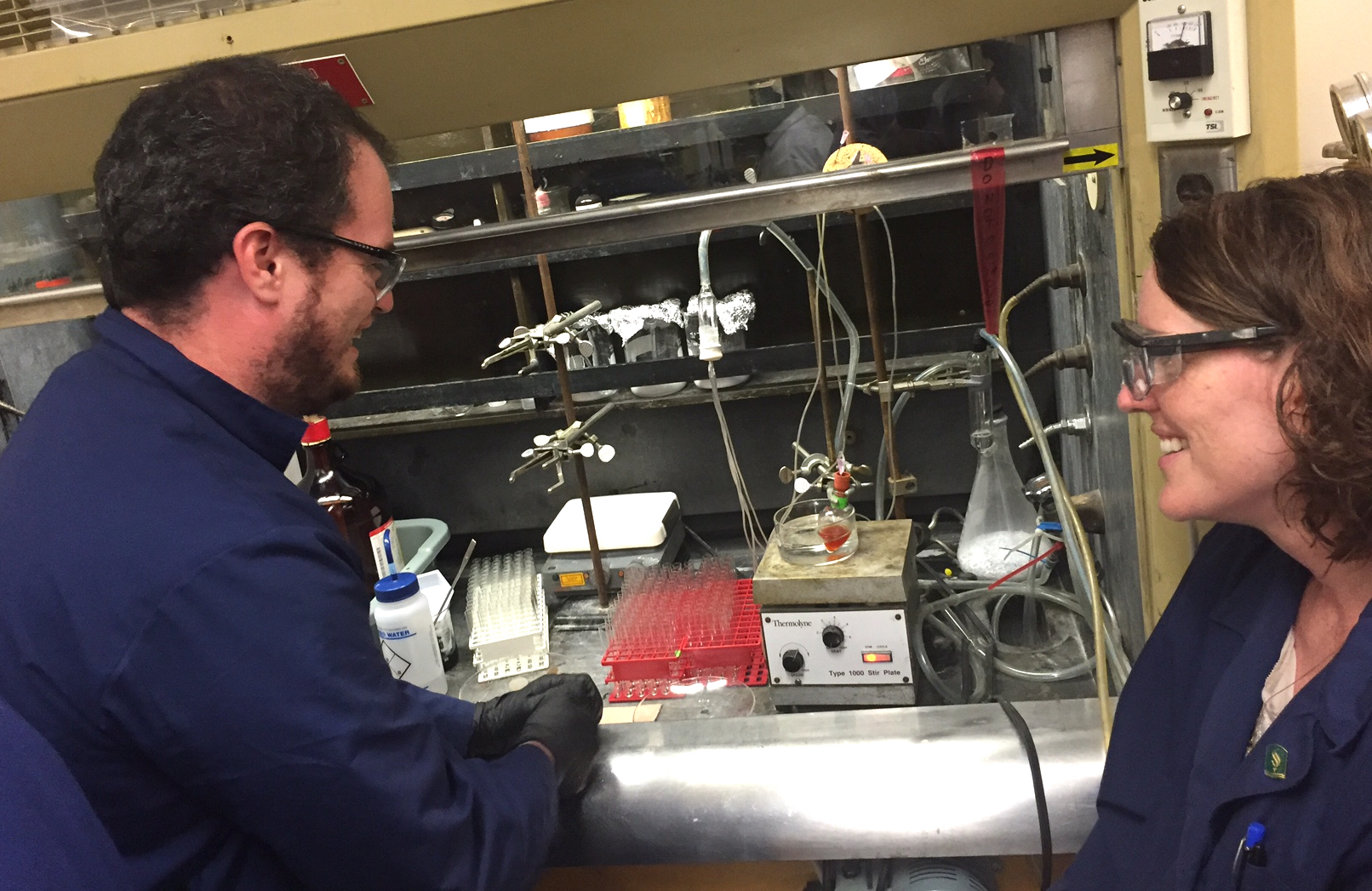 CSU Sacramento master's student, Dustin Dimas, discusses reaction conditions with Dr. Katherine McReynolds.