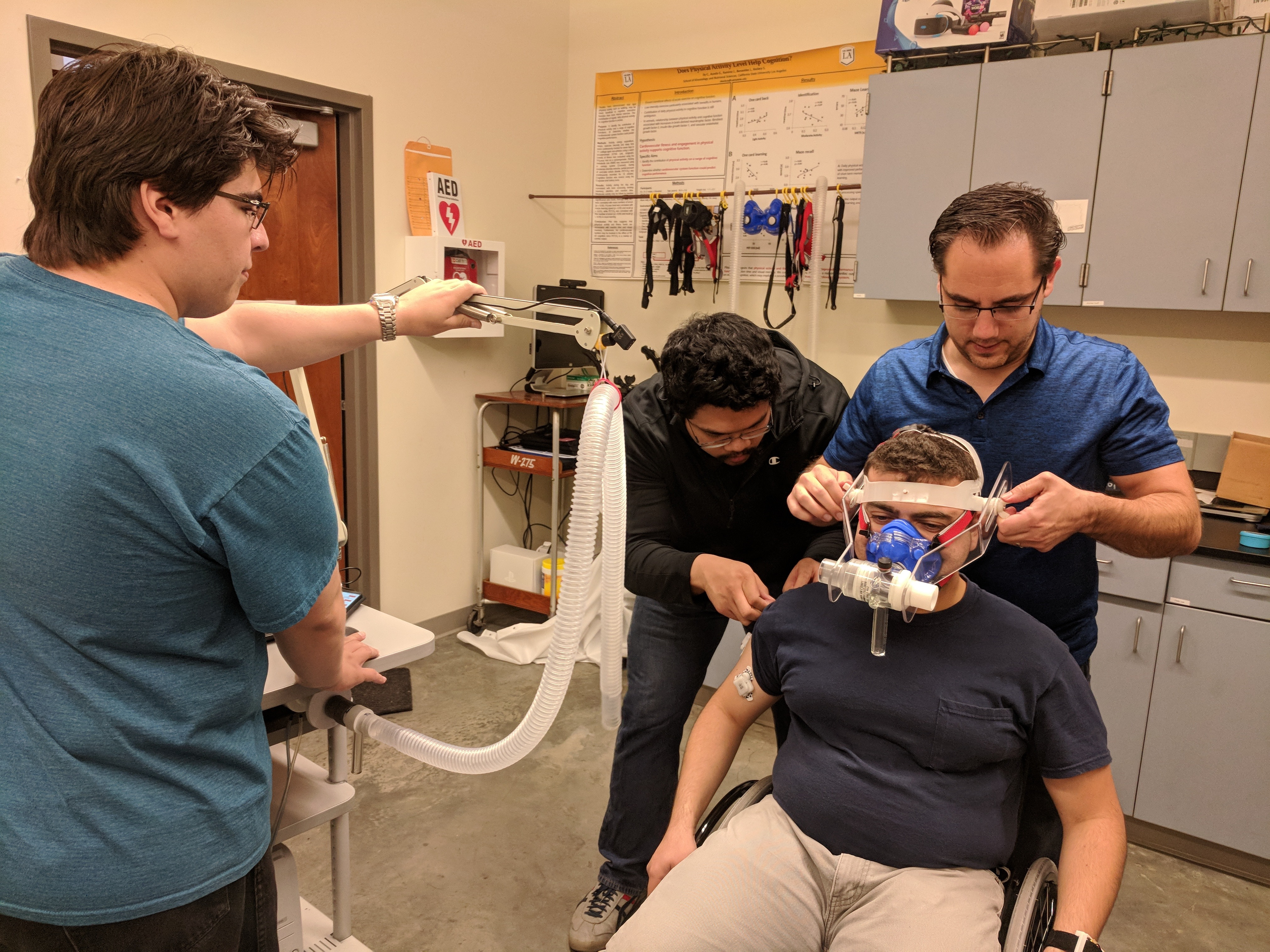 CSU Los Angeles DREAM team engineers prepare to test their exercise monitoring system.